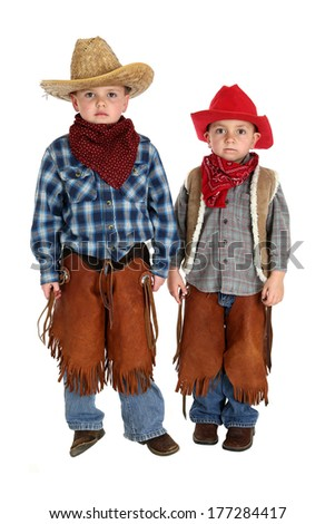 two cute young cowboys standing and posing