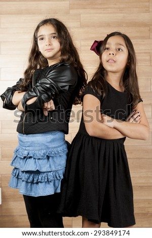 Two cute young girls indoor . - stock photo