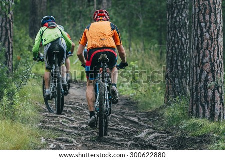 two cyclist  mountainbiker during a race in the woods - stock photo