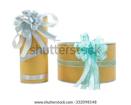 Two cylindrical gift boxes with blue and silver ribbon bows isolated - stock photo