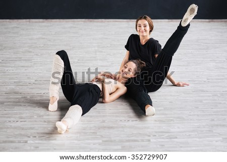 two dancers friends practice in studio