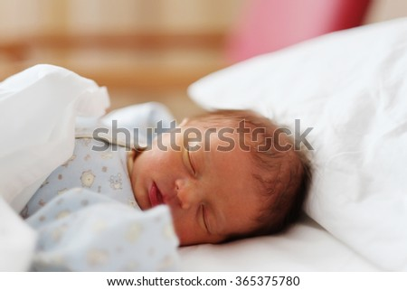 Two days old newborn baby in bed  - stock photo