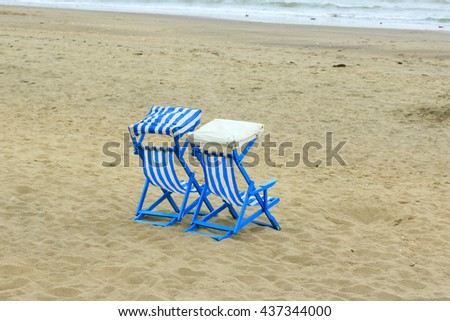 Two deck chairs on the beach at Sandown - stock photo