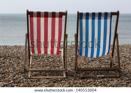 Two deck chairs on the beech. - stock photo