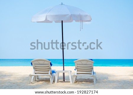 Two deckchairs on a beautiful beach . Thailand, Phuket - stock photo