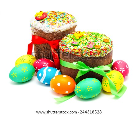 Two decorated easter cakes and eggs isolated on a white background - stock photo