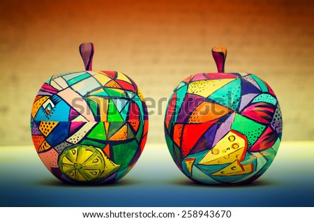 Two decorative apple, made of wood and painted by hand paints. Handmade. Modern single-piece art - stock photo
