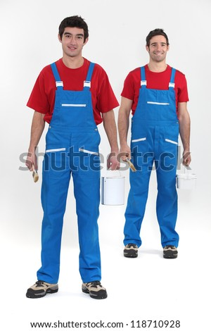 Two decorators ready to work - stock photo