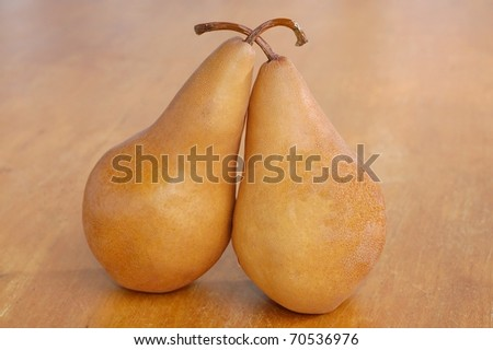 Two Delicious Bosc Pears on a Wooden Table, Still Life Photo