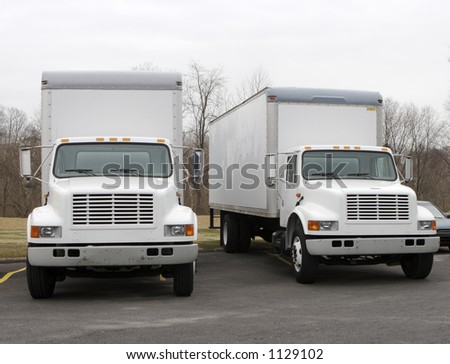 Two Delivery Trucks