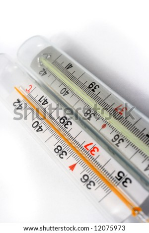Two diagonal thermometers on white