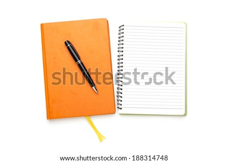 two diaries with ball pen, bookmark, ring binder, one open, one closed. - stock photo