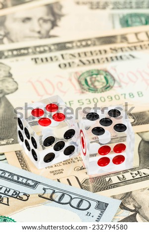 Two dice and dollar bank note concept for risk in investment
