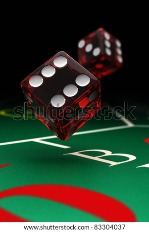 Two dice over a craps table with selective focus - stock photo