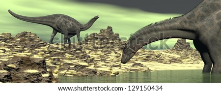 Two dicraeosaurus dinosaurs in a green desert landscape - stock photo