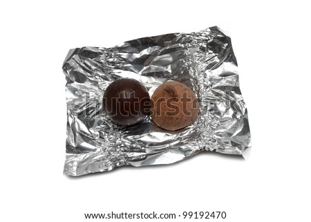 Two different chocolates on a candy wrapper from a foil. On a white background - stock photo
