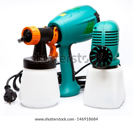 two different construction electrical airbrushes for coloration for pulverization of color  - stock photo