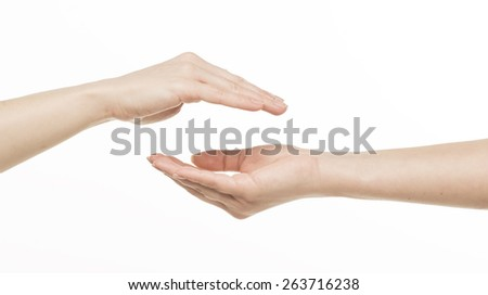 Two different female hands protecting something, Isolated on white