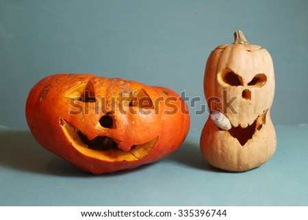 two different pumpkins on blue background