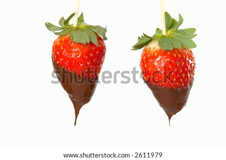 Two different strawberries with chocolate