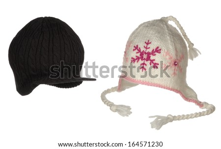 two different winter hats isolated on white  - stock photo