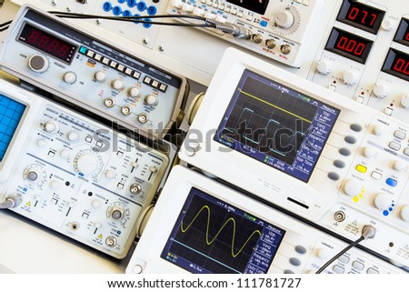 two digital oscilloscopes on measuring table in the electrical laboratory