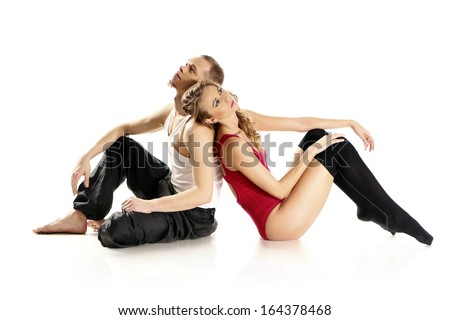 Two disillusioned young dancers sitting back based on the sad pose / Unhappy couple of lovers  - stock photo