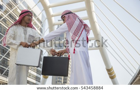 two Diverse Businessman Shaking Hand in city background, two successful businessmen shaking hands with each other,Arab and business man are shaking hand on city scape background