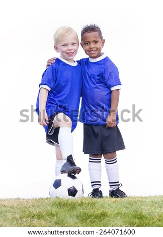 Two diverse young soccer players on white background. Full length view of two youth recreation league soccer players. - stock photo