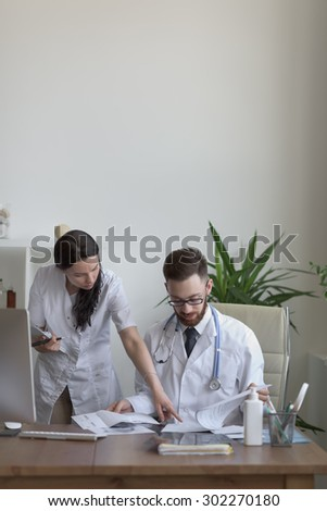 Two doctors discussing test results - stock photo