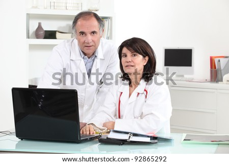 two doctors in their office - stock photo