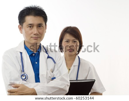 Two Doctors standing with white background - stock photo