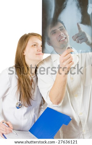 Two doctors talking, expressing satisfaction for the success of their work. - stock photo