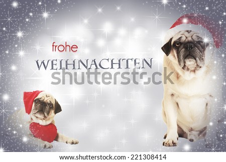 two dogs dressed as Santa Claus before glittering background, with text frohe weihnachten - stock photo