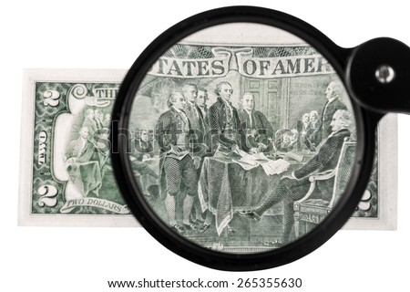 Two-dollar bill increased magnifying glass isolated on a white background - stock photo