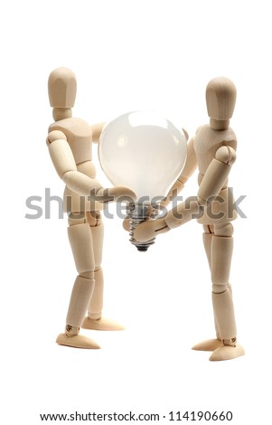 two dolls holding a light bulb - stock photo