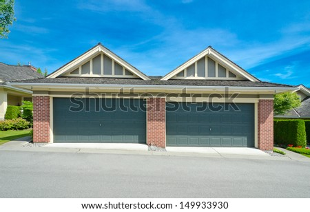 Two double doors garages. North America. - stock photo