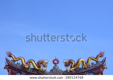two dragons of Chinese fables on rooftop of the door gate - stock photo