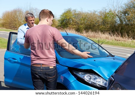 Two Drivers Arguing After Traffic Collision - stock photo
