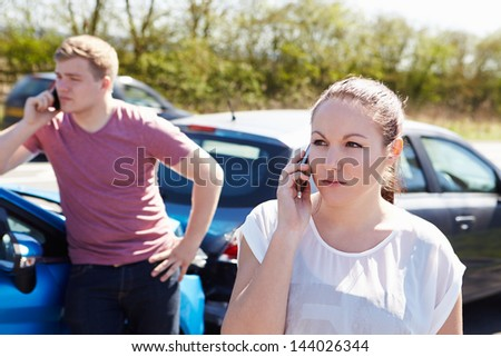 Two Drivers Making Phone Calls After Traffic Accident - stock photo