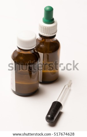 Two dropper bottles on white background for drop medication