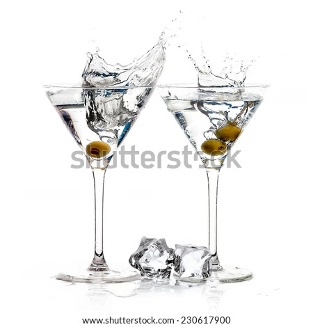Two dry martini glasses. Cocktails isolated on white background. Splash - stock photo