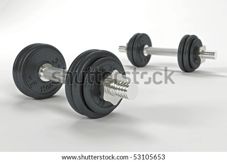 Two dumbbells with shallow depth of field