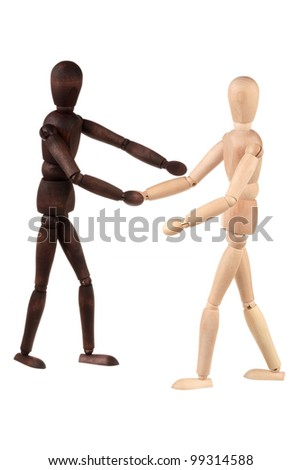 Two dummy shake hands isolated on white background - stock photo