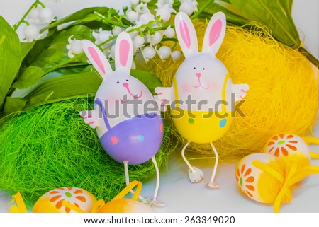 Two Easter bunnies holding hands - stock photo