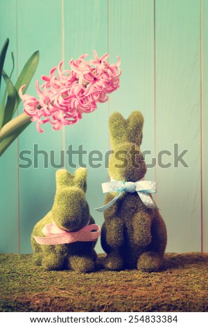 Two Easter bunnies with a pink hyacinth - stock photo