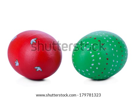 two Easter eggs, painted by hand. wooden texture. isolated on white