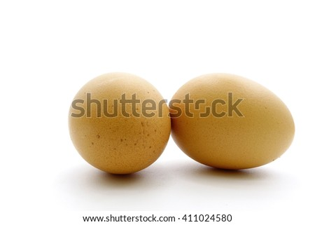 Two eggs are isolated on a white background:select focus with shallow depth of field. - stock photo