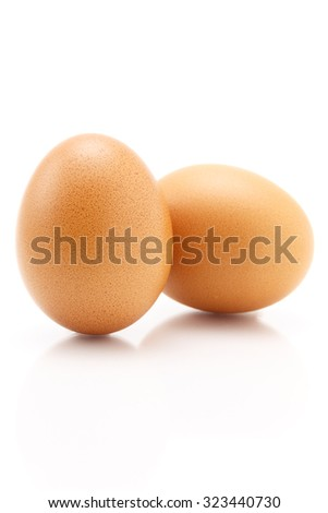 Two eggs isolated on white background, still life - stock photo