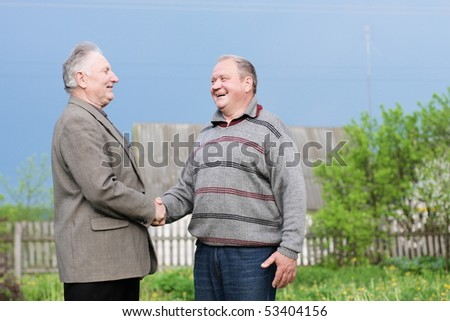 two elderly man outdoor